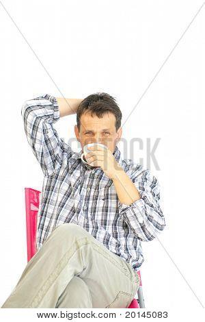 image of adult man resting with coffee mug