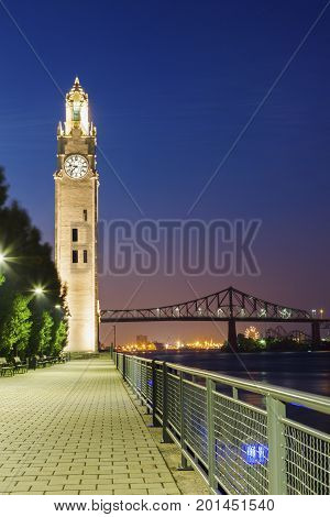 Montreal Clock Tower and Jacques Cartier Bridge. Montreal Quebec Canada.