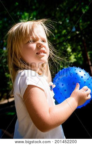 Little Girl Playing On Playground