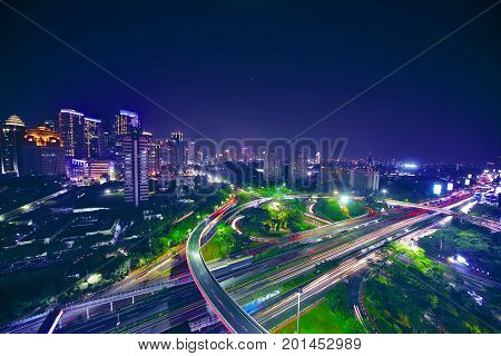 Aerial view of a beautiful downtown with interchange overpass in the night. shot in Jakarta Indonesia