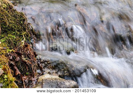 Water cascading over small rocks at Barden Reservoir
