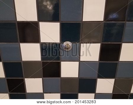 blue and white tiled wall and door stopper