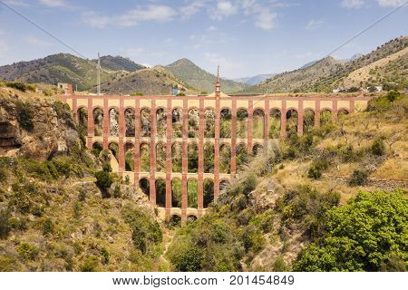 Aguila Aqueduct and blue sky. Nerja Andalusia Spain.
