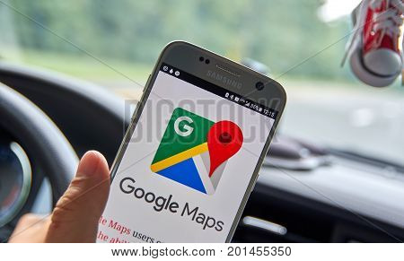 MONTREAL CANADA - AUGUST 23 2017 : Google Maps mobile app and logo. Google is an American multinational technology company that specializes in Internet-related services and products.