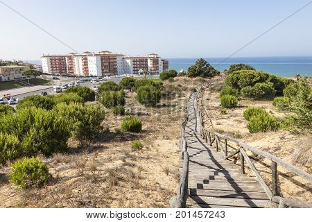 Wooden walkway at a sand dune at the atlantic coast in Matalascanas. Costa de la Luz Andalusia Spain