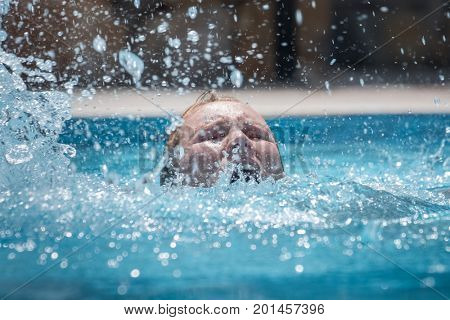 Person drowns in the pool with splashes