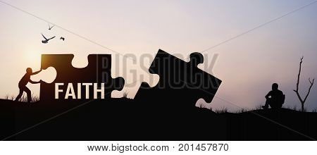 silhouette of man push jigsaw for connection with hope and faith for cooperation in business concept as belive and intention
