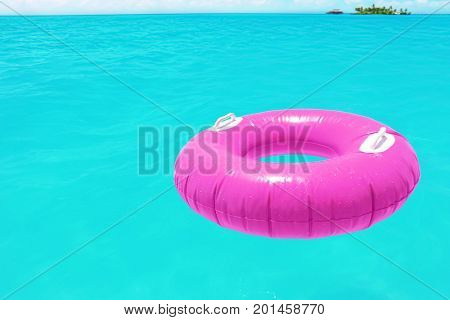 Inflatable rubber ring in clear sea water