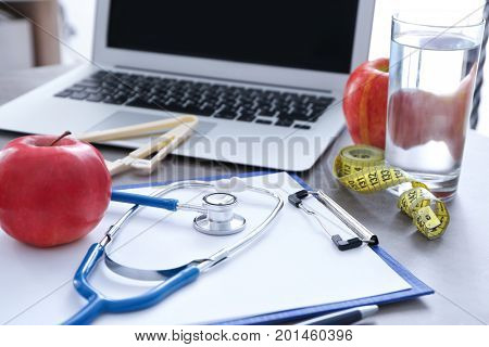 Nutritionist's workplace in clinic. Weight loss concept