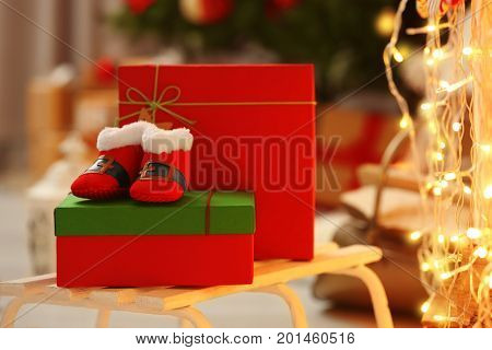 Christmas baby booties on gift box