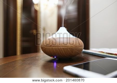 Aroma oil diffuser on table im room