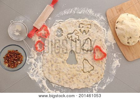 Raw dough with raisins for cookies on kitchen table