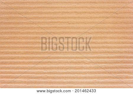 Brightly lit sunny seamless sand background. Image is ready to be tiled to create a much larger image or higher resolution background.
