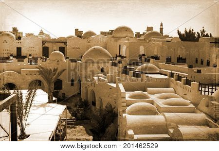 retro photo, on which image of old white structure in Egypt