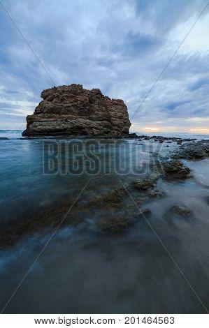 Big rock beach sunset long exposure at Santa Teresa Costa Rica