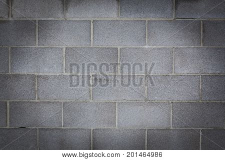 Clean and straight cinder block wall background texture with vignette