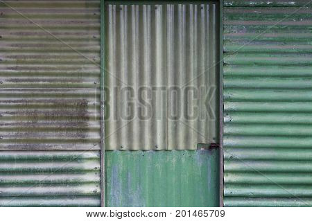 Galvanised metal sheets shed door background pattern