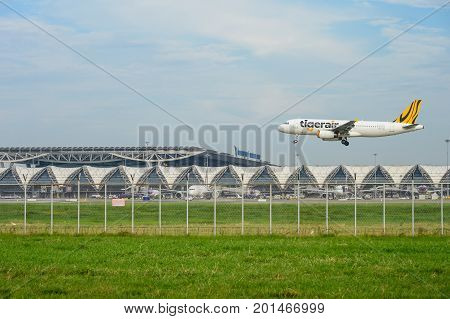 Bangkok Thailand - July 30 2017: Tiger airways (Tigerair) Plane landing to runways at Suvarnabhumi international airport in Bangkok. This airport is one of the most populated airports in the world.