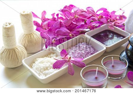 Thai Spa Treatments aroma therapy salt and sugar scrub and rock massage with orchid flower on wooden white. Healthy Concept. copy spaceselect and soft focus