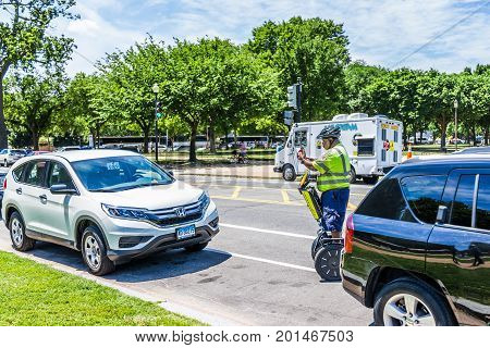Washington Dc, Usa - July 3, 2017: Police Traffic Officer Writing Ticket For Car Illegally Parked Wh