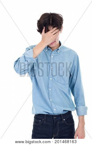 Portrait of Asian man covering his face with hands