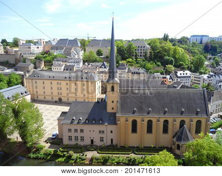 Neumunster Abbey, with stunning landscape of the Grund (Lower City) of Luxembourg City, Luxembourg