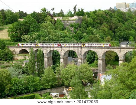 The Train Crossing the Passerelle, 24 Arches Viaduct in Luxembourg City, Luxembourg