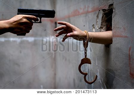 Men prisoners with shackle are trapped in the dungeons is asking for help but there are men holding the guns are going to kill him blackmail. poster