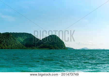 Beautiful island with tree covered mounts surrounded by blue water. The perfect place for a vacation or getaway in Langkawi