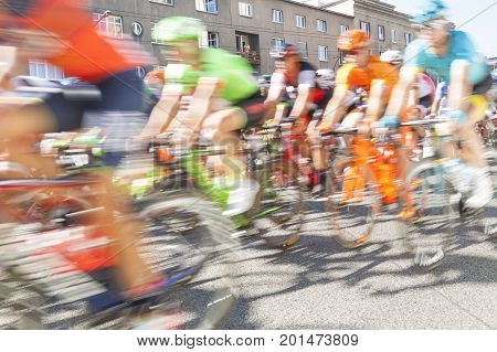 Group of cyclist during a race sunlit motion blur
