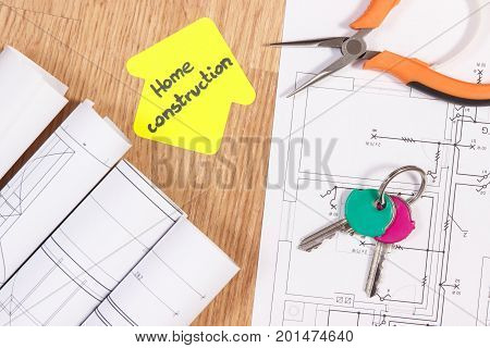 Home Keys, Metal Pliers, Electrical Drawings And House Shape With Text Home Conctruction