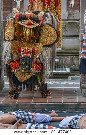 Bali, Indonesia - August 15, 2017: A regal character in a traditional Barong ceremony in Bali. The depiction of the battle between good and evil intertwines local history and mythology to create a parable for all ages.