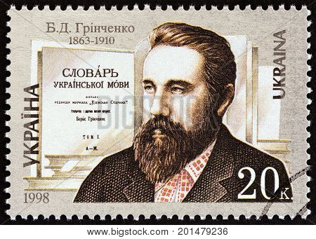 UKRAINE - CIRCA 1998: A stamp printed in Ukraine issued for the 135th anniversary of the birth of B.D.Grinchenko shows writer Borys Grinchenko, circa 1998.