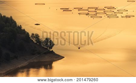 Fisherman with boat and fish farming &lake fisherman