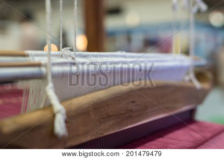 Traditional loom machine vintage style is tool for weave of making Thai silk from cocoon use by homemade in Laos and Thailand