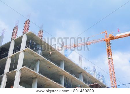 working and Crane in big construction site in develop city with copy space add text