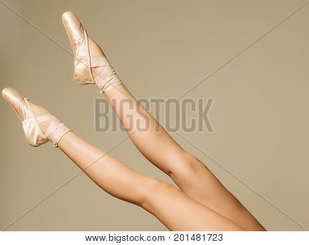 Closeup Portrait Of A Dancer In Ballet Shoes Dancing In Pointe