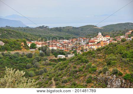 Village embedded in green landscape on greek island Samos