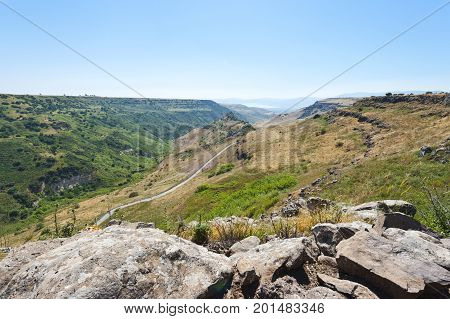 Gamla nature reserve located in the Golan Heights in Israel. View of the archaeological sites and sea of Galilee