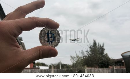 Silver Bitcoin Coin Near Airplane