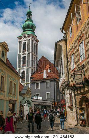 CESKY KRUMLOV, CZECH REPUBLIC - AUGUST 13, 2017: Tourist walking on the medieval street of Cesky Krumlov