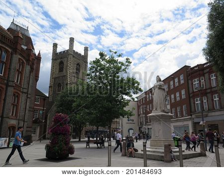 Reading England - August 4 2017: People walking in Town Hall Square on sunny summer day