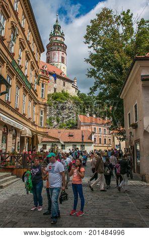 CESKY KRUMLOV, AUGUST 13, 2017: Tourists walking for the  medieval street of Cesky Krumlov