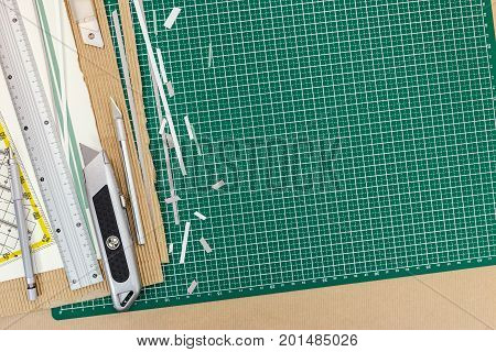 Cutting Tools On Working Desk - Utility Knife, Metal Ruler, Pencil
