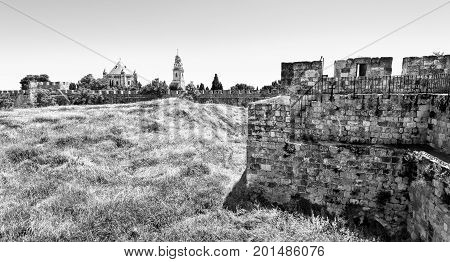 Dormition Abbey on Mount Zion in Jerusalem. Old City of Jerusalem Israel. The green hill surrounded by the ramparts with the Dormition Abbey. Black and White Picture