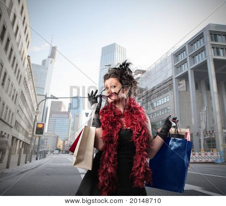 Elegant woman carrying some shopping bags on a city street