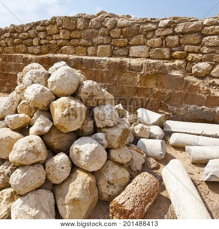 Ruins of the crusader fortress of the city Arsour in Israel. Ballista stones near the inner gate of fortification in the Israeli Apollonia national park. poster