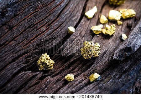 Pure gold ore on old wooden rails