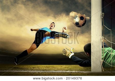 Shoot of football player and goalkeeper