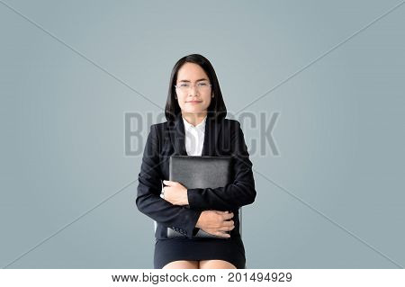 Asian Business Woman With Working Suit Sitting With File Of Document  On Light Blue Background